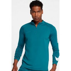 Nike Koszulka męska Nike Dry Squad Drill turkusowa r. M (859197 467). Niebieskie t-shirty męskie Nike, m, do piłki nożnej. Za 165,67 zł.