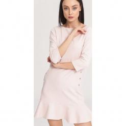 Jasnoróżowa Sukienka Effulgent. Różowe sukienki mini marki numoco, l, z dekoltem w łódkę, oversize. Za 64,99 zł.