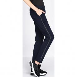 Granatowe Spodnie Dresowe Extradition. Szare spodnie dresowe damskie marki New Balance, xs, z dresówki. Za 49,99 zł.