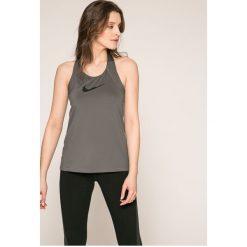 Nike - Top. Szare topy sportowe damskie marki Nike, l, z elastanu, z okrągłym kołnierzem. Za 99,90 zł.