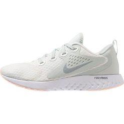 Nike Performance LEGEND REACT Obuwie do biegania treningowe summit white/wolf grey/light silver/crimson tint. Białe buty do biegania damskie marki Nike Performance, z materiału. Za 419,00 zł.