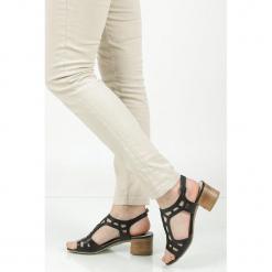 Sandały skórzane ażurowe na słupku Nessi 17155. Czarne sandały damskie na słupku marki Nessi, z materiału. Za 159,99 zł.
