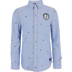 Koszula w kolorze niebieskim. Niebieskie koszule chłopięce marki Retour Denim de Luxe, z bawełny, z klasycznym kołnierzykiem. W wyprzedaży za 105,95 zł.