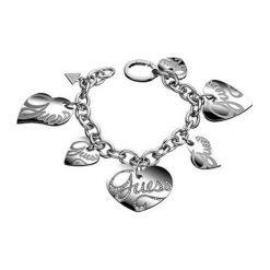 Bransoletki damskie na nogę: Bransoletka w kolorze srebrnym z zawieszkami