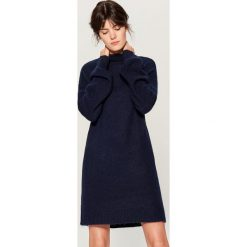 Swetrowa sukienka z wełną - Niebieski. Niebieskie sukienki z falbanami marki morimia, s, z jeansu, sportowe, z kapturem, z krótkim rękawem, mini, sportowe. Za 179,99 zł.