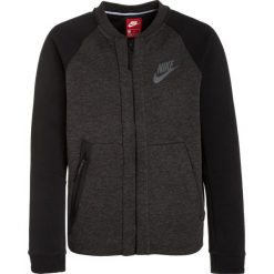 Nike Performance TECH FLEECE Bluza rozpinana black heather/black/anthracite. Czarne bluzy chłopięce rozpinane marki Nike Performance, z bawełny. W wyprzedaży za 239,85 zł.