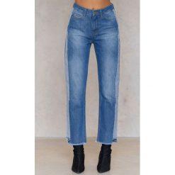 Trendyol Jeansy ze wstawkami i frędzelkami - Blue. Niebieskie proste jeansy damskie marki Trendyol, z bawełny. W wyprzedaży za 51,58 zł.