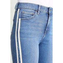 Topshop JAMIE SIDE STRIPE Jeans Skinny Fit blue denim. Niebieskie rurki damskie Topshop. Za 269,00 zł.