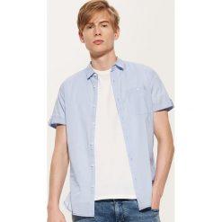 Bawełniana koszula - Niebieski. Szare koszule męskie marki House, l, z bawełny. W wyprzedaży za 39,99 zł.