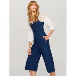 Jeansowy kombinezon - Granatowy. Niebieskie kombinezony damskie Reserved, z jeansu. Za 199,99 zł.