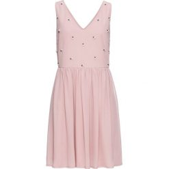 Sukienka wieczorowa z aplikacją z perełek bonprix różowobrązowy. Czerwone sukienki hiszpanki bonprix, z aplikacjami, wizytowe. Za 109,99 zł.