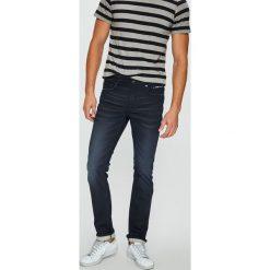 Guess Jeans - Jeansy Angels. Szare jeansy męskie skinny marki Guess Jeans, l, z aplikacjami, z bawełny. W wyprzedaży za 399,90 zł.