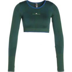 Adidas by Stella McCartney TRAIN BLOCK  Koszulka sportowa dark green. Zielone topy sportowe damskie adidas by Stella McCartney, s, z elastanu, z długim rękawem. Za 379,00 zł.