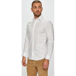 Jack & Jones - Koszula. Czarne koszule męskie na spinki marki Jack & Jones, l, z bawełny, z klasycznym kołnierzykiem, z długim rękawem. Za 129,90 zł.