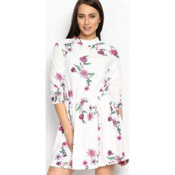 Biała Sukienka Flowerish. Białe sukienki mini marki Born2be, s, z aplikacjami, z okrągłym kołnierzem. Za 89,99 zł.