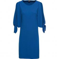 Sukienka z dżerseju z rozcięciem w rękawach bonprix błękit królewski. Czarne sukienki z falbanami marki bonprix, w koronkowe wzory. Za 74,99 zł.