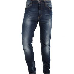 Mustang TRAMPER Jeansy Zwężane denim blue. Czarne jeansy męskie marki Mustang, l, z bawełny, z kapturem. Za 339,00 zł.