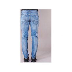 Jeansy slim fit Diesel  THOMMER. Niebieskie jeansy męskie relaxed fit marki Diesel. Za 527,20 zł.