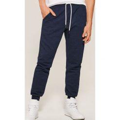 Dresowe joggery - Granatowy. Niebieskie spodnie dresowe męskie House, z dresówki. Za 69,99 zł.