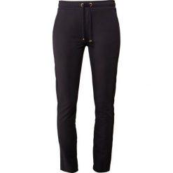 Bogner KYLIE Spodnie treningowe navy. Szare spodnie dresowe damskie marki Bogner, m, z nadrukiem, z bawełny. Za 749,00 zł.
