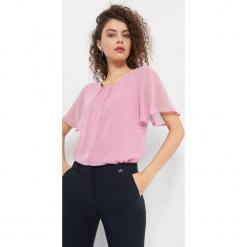 Bluzka z marszczeniem z przodu. Brązowe bluzki nietoperze marki Orsay, s, z dzianiny. Za 69,99 zł.