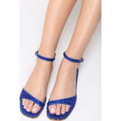 Niebieskie Sandały Silver Dawn. Niebieskie sandały damskie marki Born2be, z materiału, na obcasie. Za 59,99 zł.