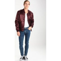 Wrangler STRANGLER Jeans Skinny Fit stonewash. Szare jeansy męskie relaxed fit marki Wrangler, l, z poliesteru, z kapturem. Za 349,00 zł.