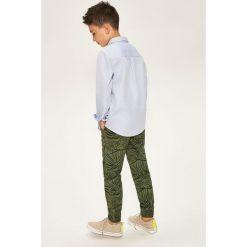 Odzież dziecięca: Spodnie jogger z nadrukiem - Khaki