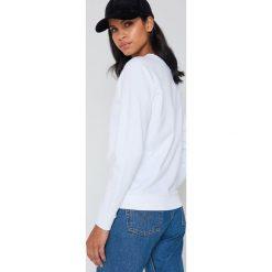 Levi's Luźna bluza Graphic Crew - White. Brązowe bluzy damskie marki Levi's®, z obniżonym stanem. Za 242,95 zł.