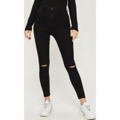 Jeansy skinny z wysokim stanem - Czarny. Białe spodnie z wysokim stanem marki Sinsay, l, z napisami. Za 49,99 zł.
