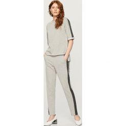 Bluza z krótkim rękawem - Jasny szar. Szare bluzy męskie rozpinane marki Reserved, l, z krótkim rękawem, krótkie. W wyprzedaży za 39,99 zł.