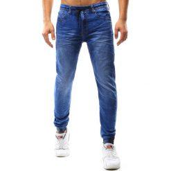Joggery męskie: Joggery męskie jeansowe niebieskie (ux1086)