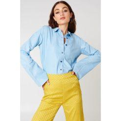 NA-KD Jeansowa koszula z szerokimi rękawami - Blue. Niebieskie koszule jeansowe damskie NA-KD. Za 80,95 zł.
