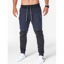 SPODNIE MĘSKIE DRESOWE P642 - GRANATOWE. Niebieskie spodnie dresowe męskie marki Ombre Clothing, z bawełny. Za 55,00 zł.