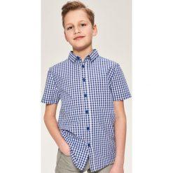 Koszula z krótkim rękawem - Granatowy. Brązowe koszule chłopięce marki QUECHUA, m, z elastanu, z krótkim rękawem. W wyprzedaży za 39,99 zł.