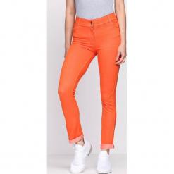 Pomarańczowe Spodnie Coordination. Brązowe spodnie z wysokim stanem Born2be, z materiału. Za 49,99 zł.