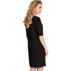 ARIA Sukienka dwie kieszenie - czarna. Sukienki małe czarne marki numoco, na imprezę, s, w kwiaty, z jeansu, sportowe, sportowe. Za 139,99 zł.