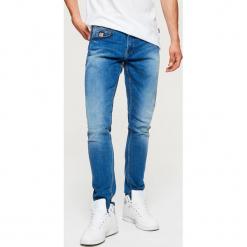 Jeansy COMFORT - Niebieski. Niebieskie jeansy męskie regular Cropp. Za 139,99 zł.