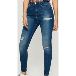 Jeansy skinny z bardzo wysokim stanem - Granatowy. Niebieskie spodnie z wysokim stanem Sinsay, z jeansu. Za 89,99 zł.