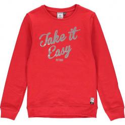 Bluza w kolorze czerwonym. Czerwone bluzy dziewczęce z nadrukiem marki Retour Denim de Luxe, z bawełny. W wyprzedaży za 105,95 zł.