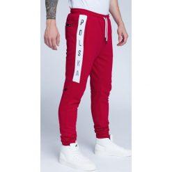 Spodnie męskie: Spodnie kibica męskie SPMD500 – CZERWONY