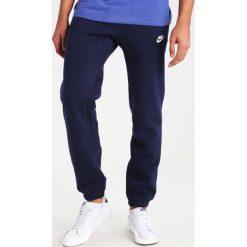 Nike Sportswear Spodnie treningowe obsidian/white. Niebieskie spodnie dresowe męskie Nike Sportswear, z bawełny. Za 379,00 zł.