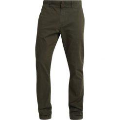Tommy Jeans ESSENTIAL Chinosy green. Zielone chinosy męskie Tommy Jeans, z bawełny. Za 399,00 zł.
