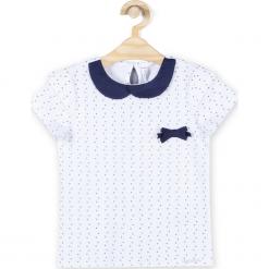 Koszulka. Białe bluzki dziewczęce bawełniane BACK TO SCHOOL GIRL, w ażurowe wzory, z klasycznym kołnierzykiem, z krótkim rękawem. Za 44,90 zł.