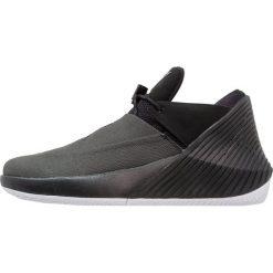Jordan WHY NOT ZER0.1 LOW Obuwie do koszykówki black/white. Czarne buty skate męskie Jordan, z materiału. Za 509,00 zł.