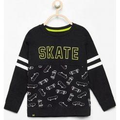 Bluza z nadrukiem - Czarny. Czarne bluzy chłopięce rozpinane marki Reserved, m, z nadrukiem. W wyprzedaży za 24,99 zł.