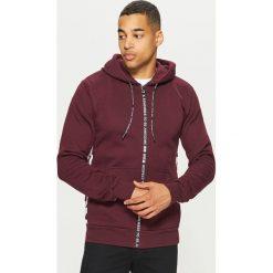 Bluza z napisami - Bordowy. Czerwone bluzy męskie rozpinane marki KALENJI, m, z elastanu, z długim rękawem, długie. Za 139,99 zł.