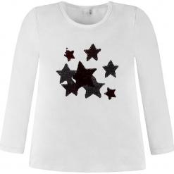 Koszulka w kolorze białym. Białe bluzki dziewczęce bawełniane Königsmühle, z okrągłym kołnierzem, z długim rękawem. W wyprzedaży za 47,95 zł.