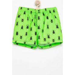 Szorty kąpielowe z nadrukiem - Zielony. Zielone kąpielówki chłopięce marki Reserved, z nadrukiem. W wyprzedaży za 24,99 zł.