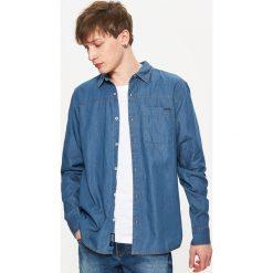 Denimowa koszula - Niebieski. Niebieskie koszule męskie Cropp, l. W wyprzedaży za 39,99 zł.